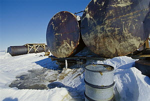 Large fuel tanks leaking at abandoned Russian research station, Ross Sea, Antarctica  -  Ingrid Visser