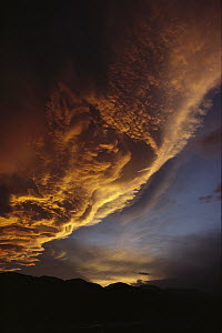 Sunset on storm clouds near Mount Cook, New Zealand  -  Ian Whitehouse