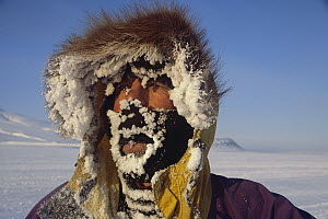 Iced-up face during skiing expedition from Ny Alesund to Longyearbyen, Spitsbergen, Svalbard, Norway  -  Colin Monteath