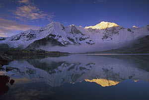 Baruntse, 7220 meters elevation, and mountaineering camp reflected in alpine lake, Makalu-Barun National Park, Nepal  -  Colin Monteath