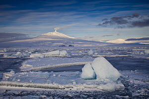 Mount Erebus at midnight with ice floes in McMurdo Sound, Ross Island, Antarctica  -  Colin Monteath