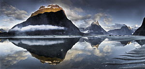 Mitre Peak reflecting in Milford Sound in winter at dawn, Fiordland National Park, New Zealand  -  Colin Monteath