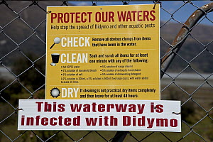Didymo (Didymosphenia geminata) warning sign, diatom bloom seriously affecting South Island waterways and rivers, Mount Cook National Park, New Zealand  -  Colin Monteath