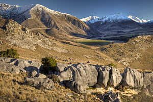 Boulders of Prebble Hill with Torlesse Range behind, Castle Hill Basin, Canterbury, New Zealand  -  Colin Monteath