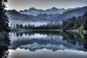 Lake Matheson reflection with predawn winter light on Mount Tasman and Mount Cook, near Fox Glacier, Westland National Park, New Zealand - Colin Monteath