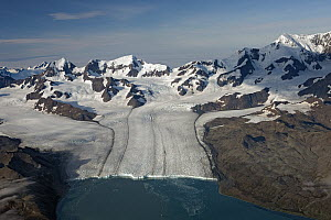 Nordenskjold Glacier with Allardyce Range showing medial moraine and glacial foot, South Georgia Island  -  Ingo Arndt