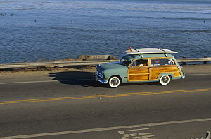 Pleasure Point surf check in a 1950 Ford Woodie owned by Jim Cocores, Santa Cruz, California  -  Bob Barbour