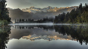 Mount Tasman and Mount Cook reflected in Lake Matheson, South Island, New Zealand - Colin Monteath