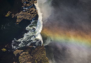 Victoria Falls cascading 420 feet into chasm, largest waterfall in the world with rainbow, UNESCO World Heritage Site, Zimbabwe - Vincent Grafhorst