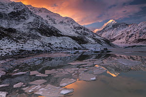 Mount Cook reflection in ice covered Mueller Lake, Mount Cook National Park, Canterbury, New Zealand  -  Colin Monteath