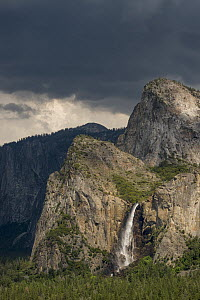 Rock formations and waterfall, Lower and Middle Cathedral Rocks, Bridal Veil Falls, Yosemite National Park, California  -  Jeff Foott