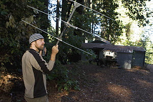 Mountain Lion (Puma concolor) biologist, Paul Houghtaling, using telemetry to track mother and cubs near houses, Santa Cruz Puma Project, Santa Cruz, Monterey Bay, California - Sebastian Kennerknecht