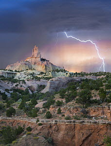Lightning strike near rock formation, Church Rock, Red Rock State Park, New Mexico  -  Tim Fitzharris
