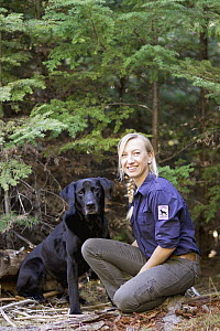 Domestic Dog (Canis familiaris) named Sampson, a scent detection dog with Conservation Canines, and field technician Julianne Ubigau, northeast Washington - Jaymi Heimbuch