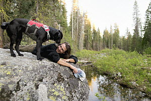 Domestic Dog (Canis familiaris) named Winnie, a scent detection dog with Conservation Canines, and field technician Caleb Staneck, Sierra Nevada, California - Jaymi Heimbuch