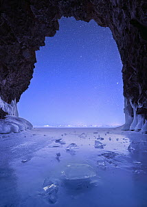 Cave at night during polar vortex, Lake Superior, Tettegouche State Park, Minnesota, multiple exposures  -  Benjamin Olson