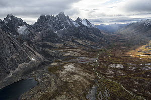 River flowing through valley in autumn, Tombstone Mountains, Tombstone Territorial Park, Yukon, Canada  -  Peter Mather