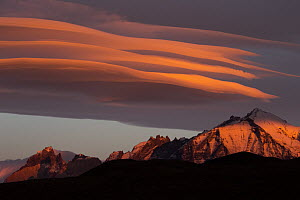 Clouds at sunrise over mountain range, Torres del Paine National Park, Patagonia, Chile  -  Sebastian Kennerknecht