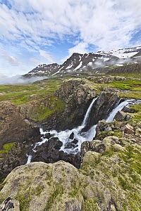 River with waterfalls in tundra, Klifbrekkufossar Waterfall, Mjoifjordur, Iceland - Yva Momatiuk & John Eastcott