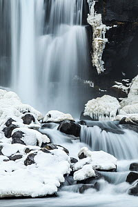 Waterfall in winter, Oxararfoss Waterfall, Thingvellir National Park, Iceland - Heike Odermatt