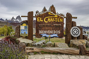 Welcoming sign for town with peaks, mirroed by mountains in background, El Chalten, Patagonia, Argentina  -  Shane P. White