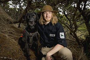 Domestic Dog (Canis familiaris) named Hooper, a scent detection dog with Conservation Canines, with field technician Will Chrisman, Oregon Dunes National Recreation Area, Oregon  -  Jaymi Heimbuch