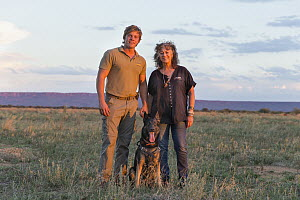 Domestic Dog (Canis familiaris), scent detection dog, with Cheetah (Acinonyx jubatus) conservationist, Laurie Marker, and staff member, Cheetah Conservation Fund, Namibia  -  Suzi Eszterhas