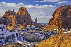 Winding road and sandstone formations, La Sal Mountains, Arches National Park, Utah  -  Jeff Foott