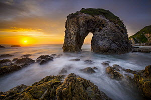 Coastal rock arch at sunset, Bermagui, New South Wales, Australia  -  Gary Bell/ Oceanwide