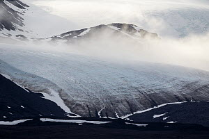Mountain and glacier with fog, Lilliehookbreen Glacier, Krossfjorden, Svalbard, Norway  -  Heike Odermatt