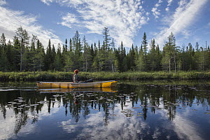 Canoer paddling, Junco Lake, Superior National Forest, Minnesota  -  Benjamin Olson