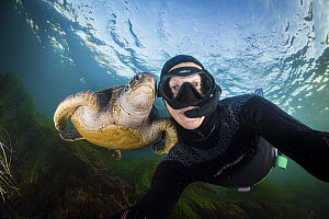 Photographer Ralph Pace with sea turtle  -  Ralph Pace