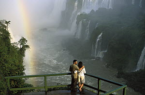 Tourists admiring the Iguacu Falls, world's largest waterfalls and the largest tourist attraction in the Atlantic Forest ecosystem, Brazil and Argentina border  -  Mark Moffett