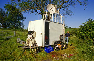Communications van in field for sending live pictures for Bird in the Nest series, 1995  -  Charlie Hamilton James