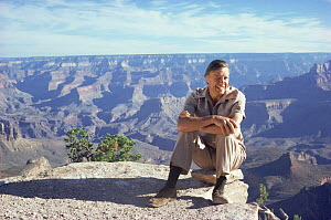 David Attenborough by Grand Canyon on location for BBC Life on Earth series, Arizona, USA, 1980s  -  John Sparks