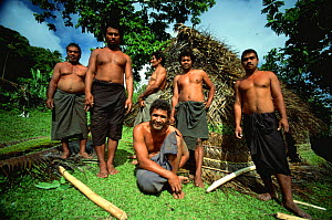 Niuafo'ou villagers outside the fale hut the have built in a day, Tonga  -  Phil Chapman