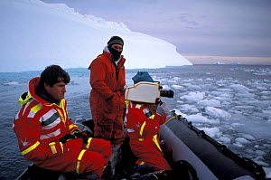 Alastair Fothergill and Paul Atkins filming off rubber dinghy, filming for BBC Life in the Freezer series - Ben Osborne