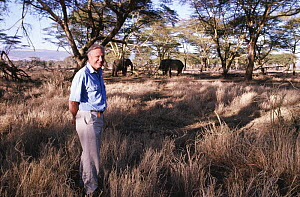 David Attenborough and African elephants (Loxodonta africana) on location for BBC Private Life of Plants, Lewa Downs, Kenya, 1993  -  Keith Scholey