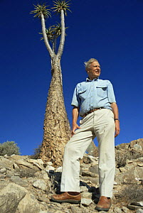 David Attenborough beside to Giant aloe (Aloe pillansii) South Africa, on location for BBC series Private Life of Plants, 1993 - NEIL NIGHTINGALE
