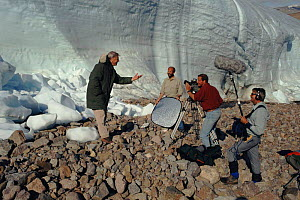 David Attenborough with film crew on Ellesmere Island, when on location as presenter of BBC television series 'The Private Life of Plants' 1995 - NEIL NIGHTINGALE