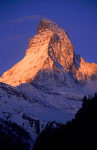 Matterhorn mountain with sun on upper slopes. Switzerland  -  Christoph Becker