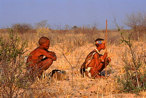 Bushmen rest from tracking. Bushmanland. Namibia - Keith Scholey