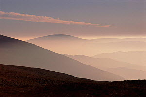 View from the summit of Cadair Idris, Snowdonia NP, Wales. Clouds and moutains. - David Noton