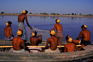 Fishermen wearing masks to protect from tiger attack. Sunderband, W Bengal, India. Tigers attack by biting back of neck, mask with prominent eyes intended to mislead and prevent tiger from attacking f... - Ashok Jain