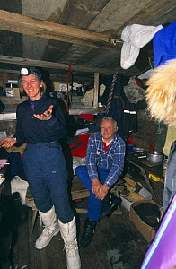 Producer Martha Holmes and cameraman Martin Saunders inside Texas Bar hut, Svalbard, Norway, on location for Polar Bear film special, 1996  -  Mats Forsberg