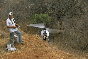 Geoff Bell with remote controlled filming helicopter for tv series Lifesense, Kenya, 1990  -  John Downer