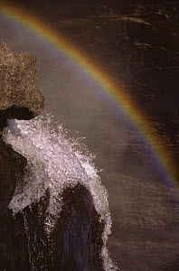 Victoria Falls - water at bottom of falls with rainbow  -  Leo & Mandy Dickinson