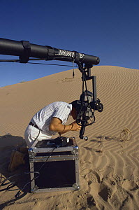 "Cameraman Gavin Thurston on location in the Sonoran Desert, California, using a Jimmy Jib to film plants for BBC television series ""Private Life of Plants"", early 1990s - Neil Lucas"