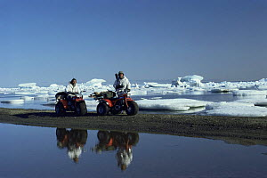 Cameraman Hugh Miles and producer  Mike Salisbury on Honda trikesw,  Bailey Pt, Canada. On location for BBC series Kingdom of the Ice Bear, 1983  -  Mike Salisbury