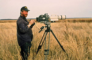 Cameraman Jeff Turner on lookout for wolves, Wood Buffalo NP, Canada, 1996  -  Jeff Turner